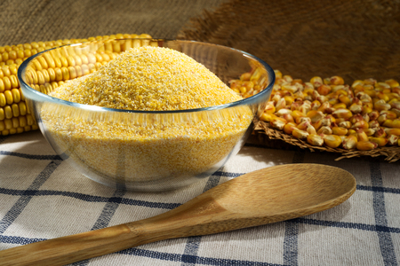 maize: Maize and cornmeal in glass bowl Stock Photo