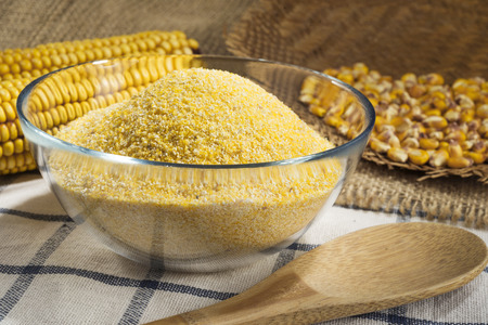 tat: Maize and cornmeal in glass bowl Stock Photo