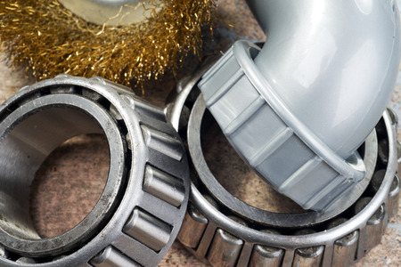 bearings: roller bearings, wire brush and plastic tube Stock Photo