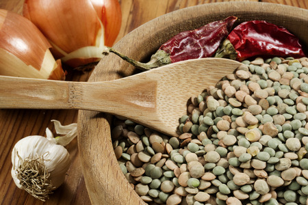Lentils in a wooden bowl photo