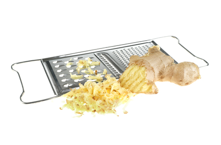 Ginger and kitchen grater isolated on white  Standard-Bild