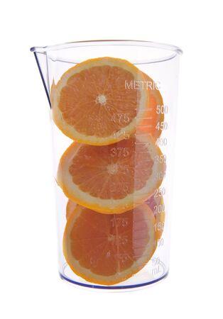 fresh graduate: Sliced fresh orange in graduated measure, isolated on white