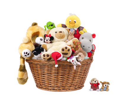 Stuffed animal toys in a basket isolated on a white