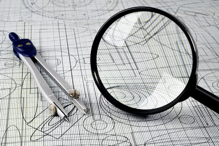 drawing,  magnifying glass and compasses photo