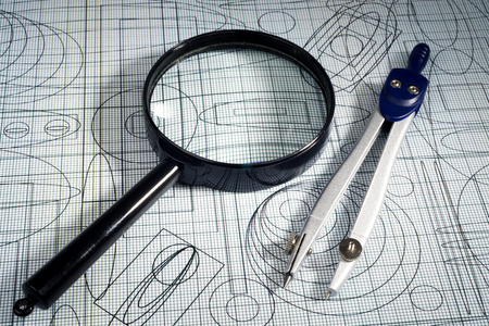 plotting: drawing,  magnifying glass and compasses