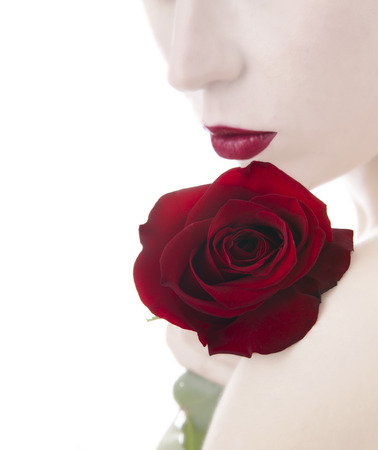 beautiful woman and rose,  isolated on white photo