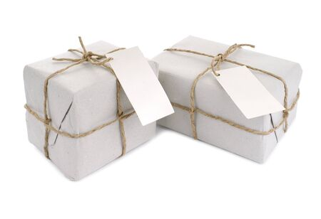 pack string: Parcels wrapped with  paper, tied with string and with blank label