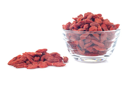 red dried goji berries ( wolfberry ) in glass bowl, isolated on white