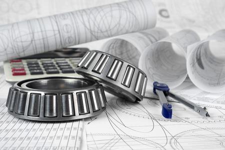 roller bearings, compasses, calculator  and drawings 写真素材