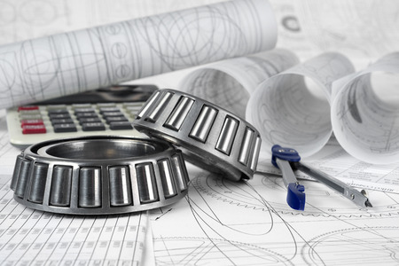 roller bearings, compasses, calculator  and drawings Stock Photo