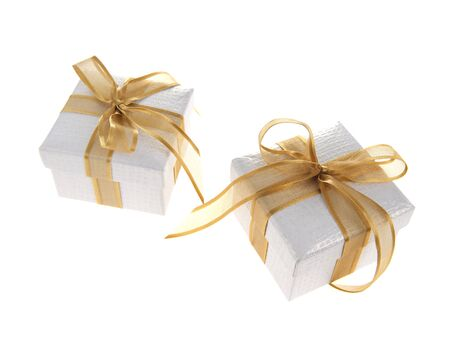 Gift boxes with golden ribbon bow,isolated on white photo