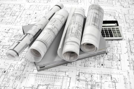 construction plans: Grey folder document, calculator and project drawings Stock Photo