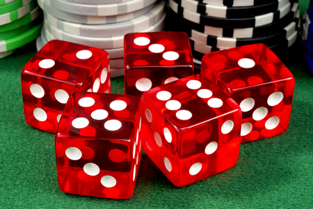 red dice: Red dice and chips on a green felt