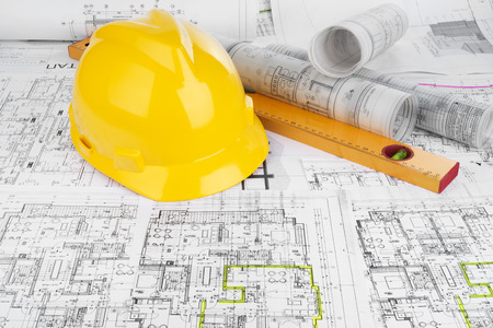 construction level: Yellow helmet, level and project drawings Stock Photo