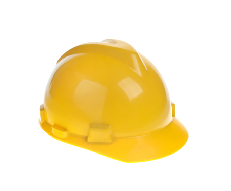 Yellow constructional helmet isolated on white background
