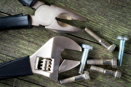 tools and bolts on wooden background, selective focus 版權商用圖片 - 91780895