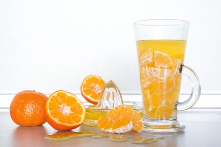 Fresh tangerines and  citrus juice,  on kitchen bar Stock Photo
