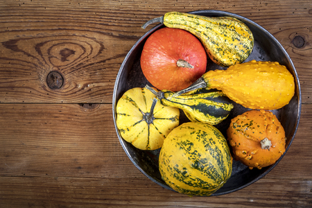 Decorative pumpkins on wooden table