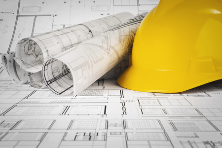 Yellow helmet and project drawings