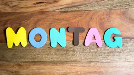montag: word Montag formed by colorful letters