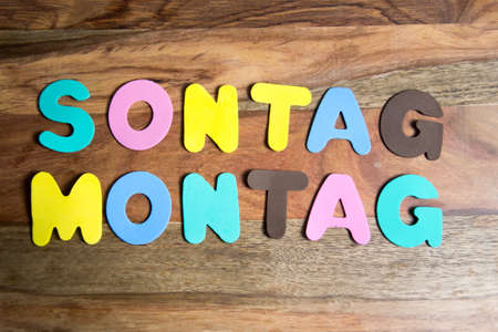 sonntag: words Sonntag and Montag formed by colorful letters Stock Photo