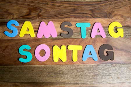 sonntag: words Sonntag and Samstag formed by colorful letters
