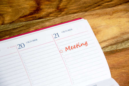 marked: daily planner with meeting marked