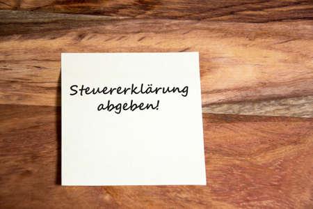 rung: german text steuererkl�rung abgeben on paper note Stock Photo