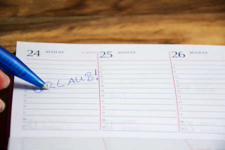 daily planner: Daily planner with vacation marked Stock Photo