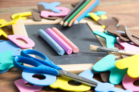 school supplies: slate with some school tools Stock Photo