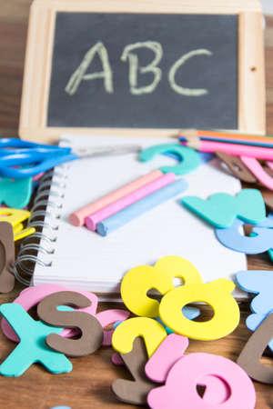 slate: slate with some school tools Stock Photo