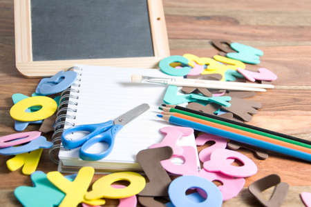 first grader: slate with some school tools Stock Photo