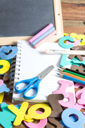 grader: slate with some school tools Stock Photo
