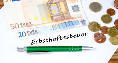 change purses: the german word Erbschaftssteuer on a white paper Stock Photo