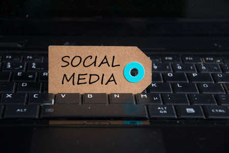 social media written on paper tag on a keyboard Stock Photo