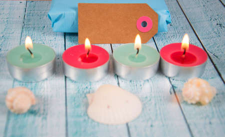 paper tag with tea lights and shells Stock Photo