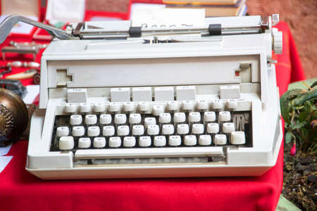a white typewriter on a flea market