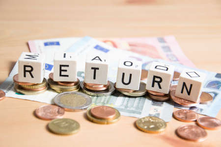 Return word written on wood cube Stock Photo