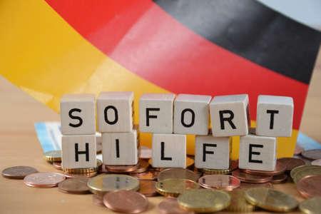 Soforthilfe( german word for emergency relief ) Standard-Bild