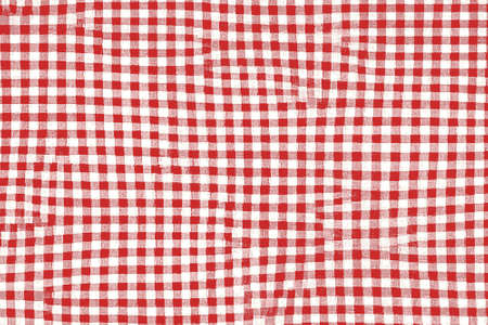 Red picnic blanket fabric with squared patterns and texture Archivio Fotografico