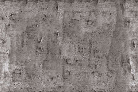 Old damaged inscribed texture of a cracked wall