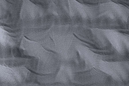 Texture of shifting sands with wind marks