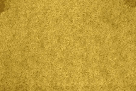 Texture of a gold recycled paper  background Imagens
