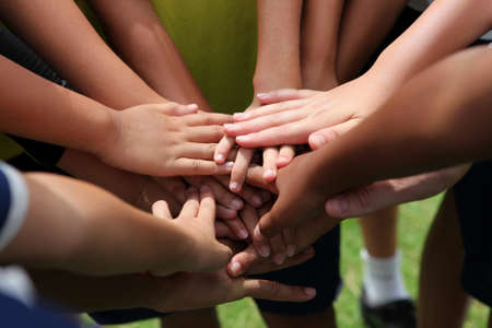youth football: group of young people s hands Stock Photo