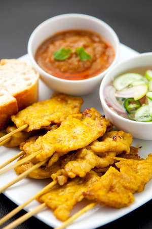 malaysia culture: Grilled Pork Satay with Peanut Sauce and Vinegar Stock Photo
