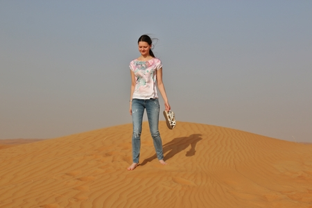runing: girl runing in desert near Dubai, United Arab Emirates