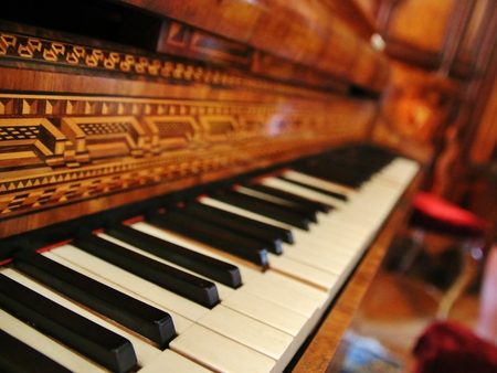 antique: Closeup of old black and white piano keys and wood grain