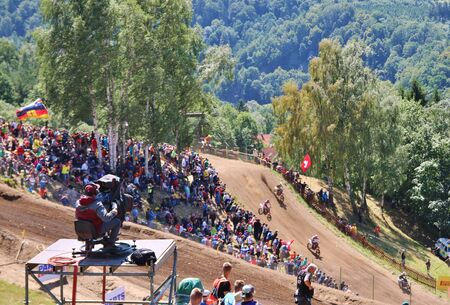 motorcross: Loket, Czech Republic: Motocross riders perform on the competes during the MXGP World Championship on July 26, 2015 in Locket, Czech Republic