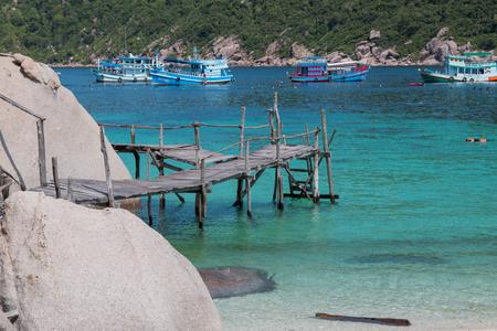 phangan: Wooden bridge on Koh Nang yuan Island in Thailand next to Sumui