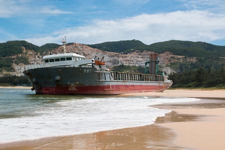 Abandoned Cargo ship sailing on the beach, China Stock Photo